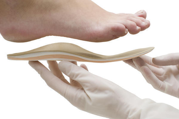 What does a sharp pain in the heel of my foot indicate?