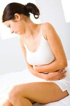What causes pain in the lower abdomen in women?