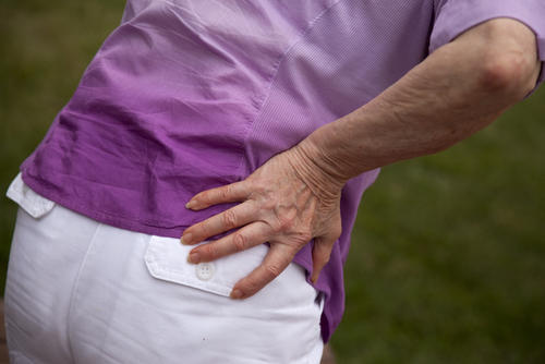 What causes severe waist and back ache?