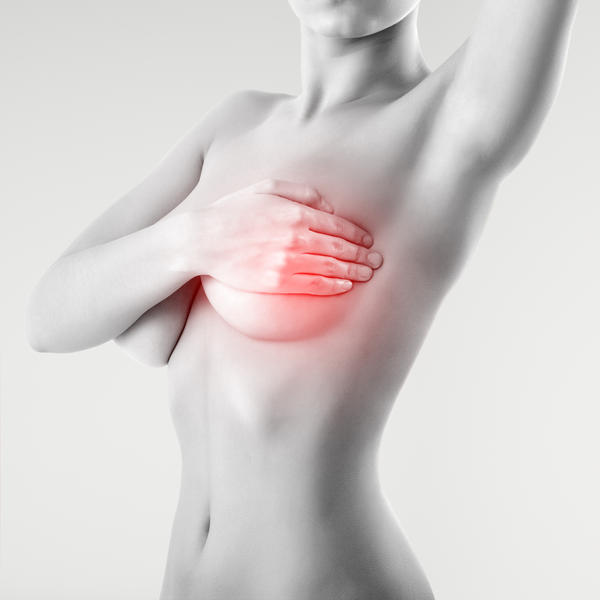 What can be causing a painful breast lump and hand/arm pain?