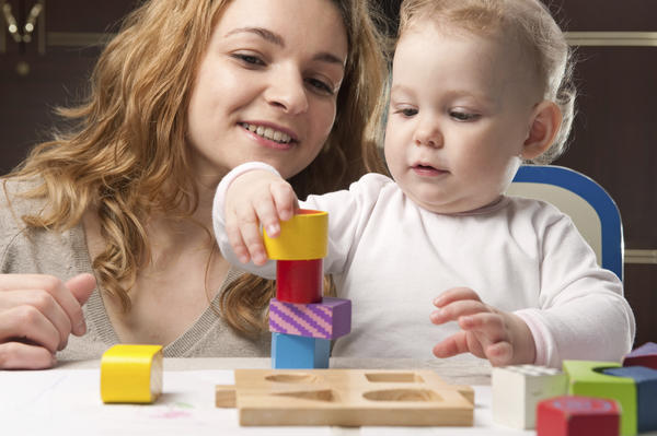 What developmental signs can I expect near my child's one year birthday?