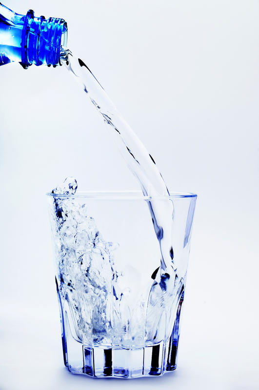 How many glasses of water should a 50 year old woman drink a day?