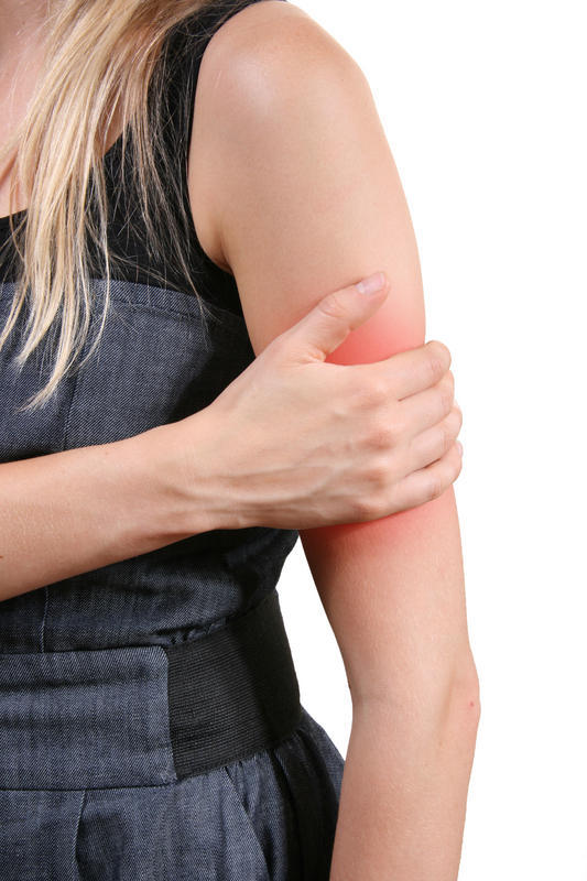 What can cause arm pain while at rest?