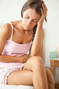 Is it normal to get a light period with heavy pains?