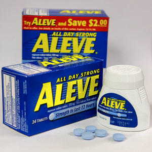I have been taking Aleve (naproxen)  everyday for my knee  now i notice brown spots on the bottom of my feet?