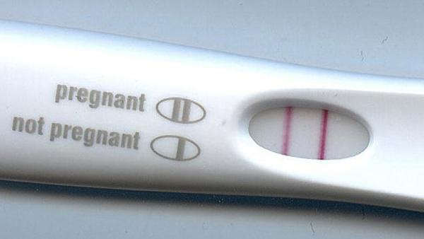 I ovulate late i been having pregnancy symptoms im 4 days late took a test got negative?