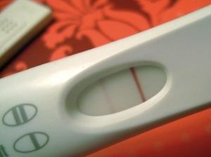 I had 2 faint positive tests, then 3 negatives. Cramping bad & i had extreme light bleeding for 2 weeks starting at 2 weeks past ovulation am i pregnant?