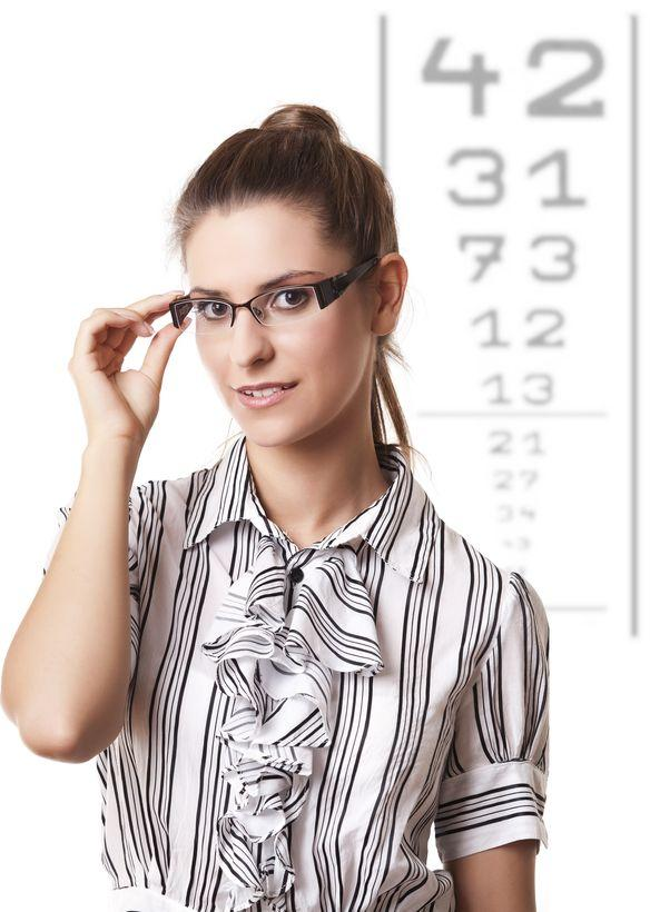How can the opticians find out the eye power by looking at old spectacles?