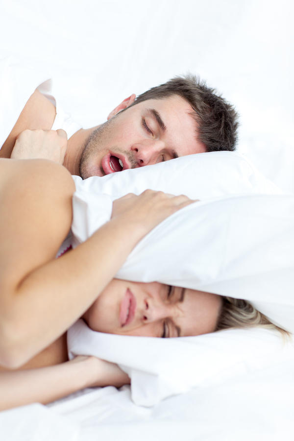 How can I treat on the back mild sleep apnea? I am female and normal weight. I snore very loudly and this disturbs my husband.