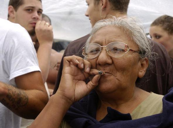Is smoking marijuana associated with lung cancer in the same way as smoking cigarettes?
