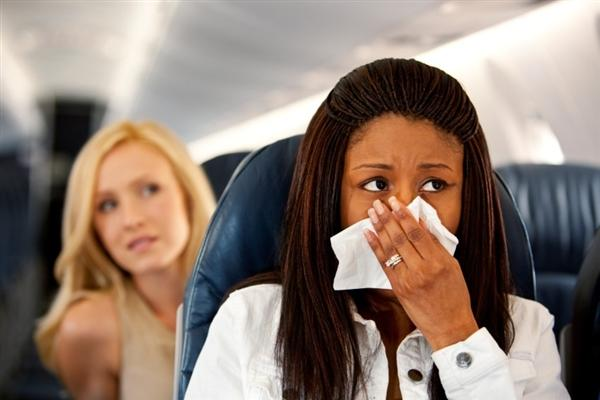 Is it safe to be flying with a sore throat?