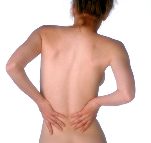 I have sharp pains in my lower back when i bend my back and lower my chin to my chest, what's wrong?