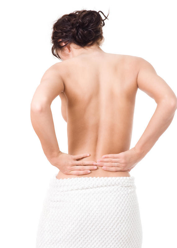 What are the causes of lower back pain in women?