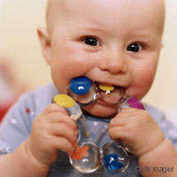 How long does excessive chewing associated with teething last?