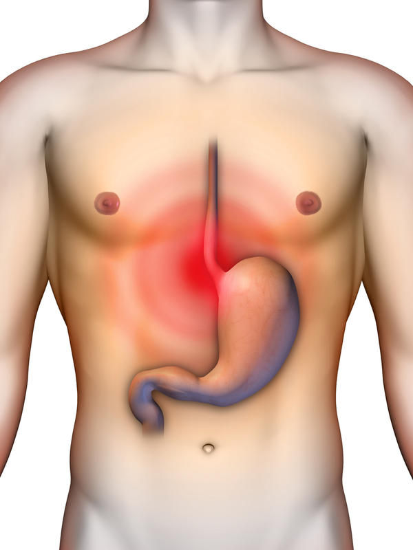 What fruit or medication can treat too much stomach acid?