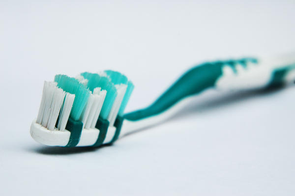Is it better to brush your teeth before or after you eat?