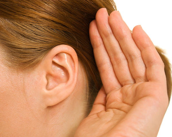 What are symptoms of ear infection in kids under the age of two?