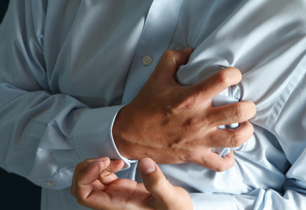 Can acid reflux cause a chest tightness (NOT the burning) that mimics heart attack?
