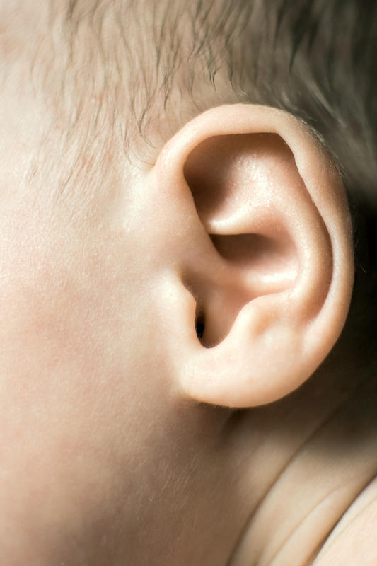 Which organism causes middle ear infections in HIV patients?
