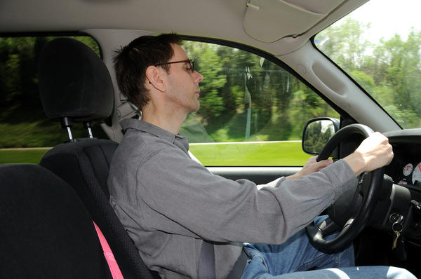 What can cause someone to develop carsickness?