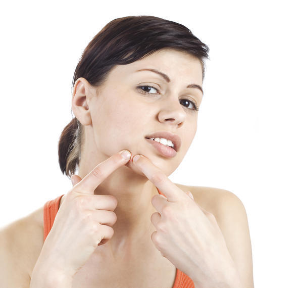 Is there a direct connection between a painful, swollen right submandibular lymph node and a bad acne breakout?