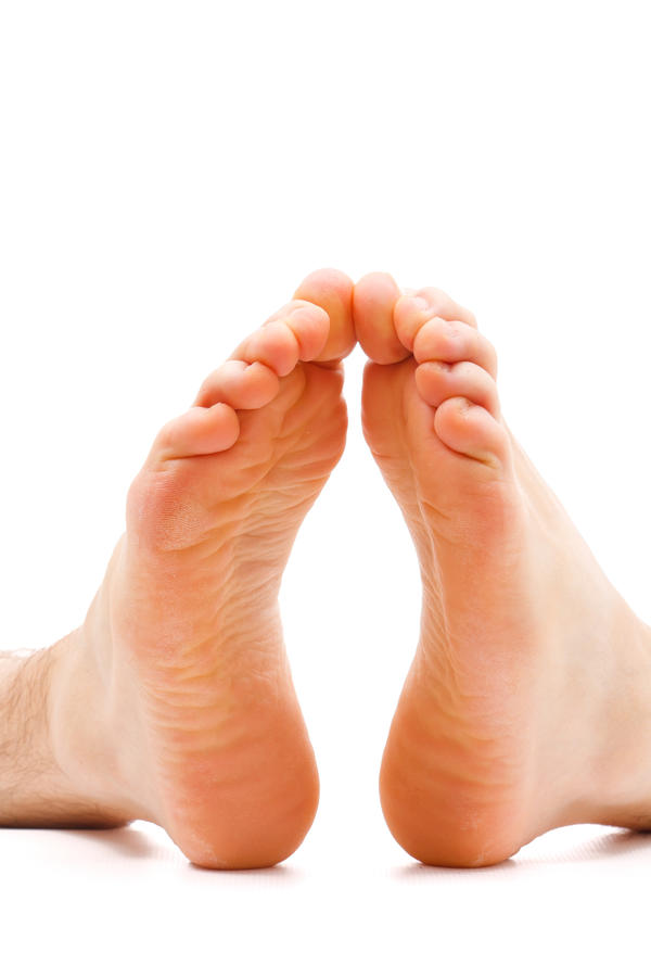 What is the cause of involuntary toe flex downward plantar?