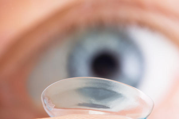 How can I get rid of stuck contact lens?