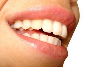What causes tingling sensations in teeth and gums?