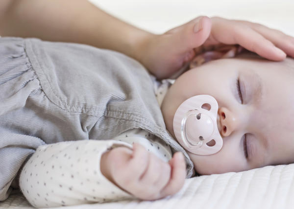 When is it safe to allow a baby to sleep on his stomach?