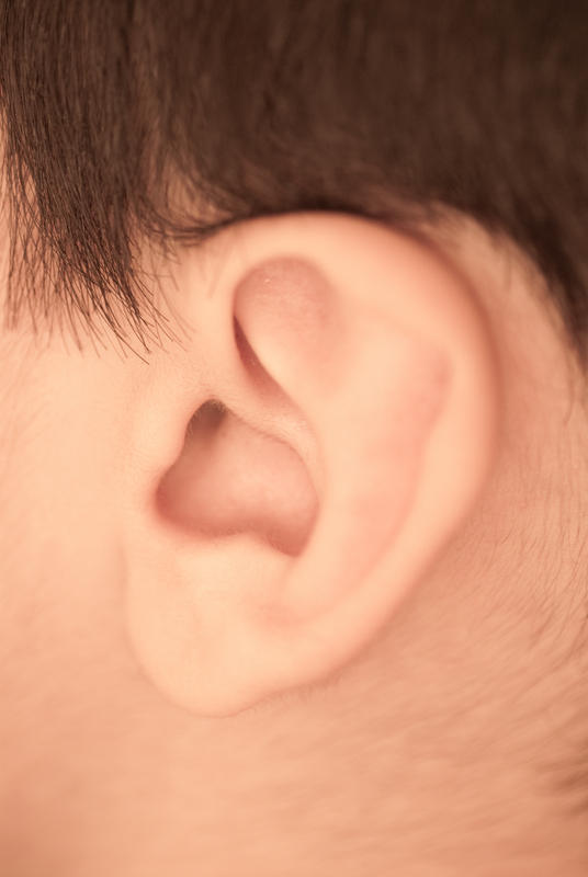 Hearing loss (with middle ear effusion in right ear), enlarged firm mastoid node on same side for 10 months, nose chronically blocked. Possible cause?