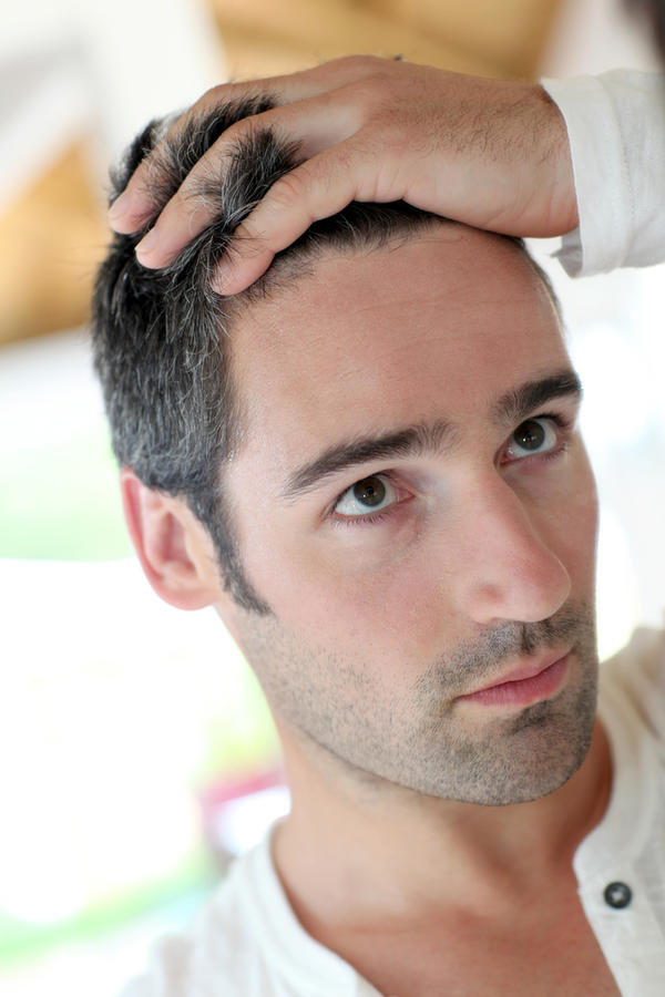 I am experiencing  hair loss (quality: patchy spots) . The following also describe me: Skin redness or irritation and Excessive sweating. How many times should i shampoo my hair?