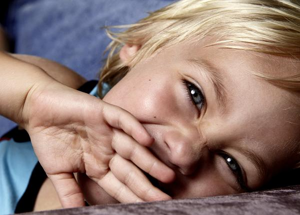 What does it mean when a child rubs eyes and they are red?