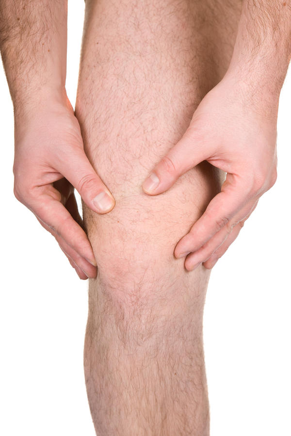 What could pain in the front of a person's right leg mean?