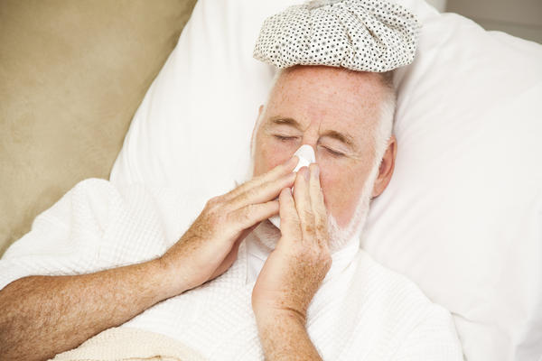How can you tell the difference between a moderately bad cold and a mild flu?