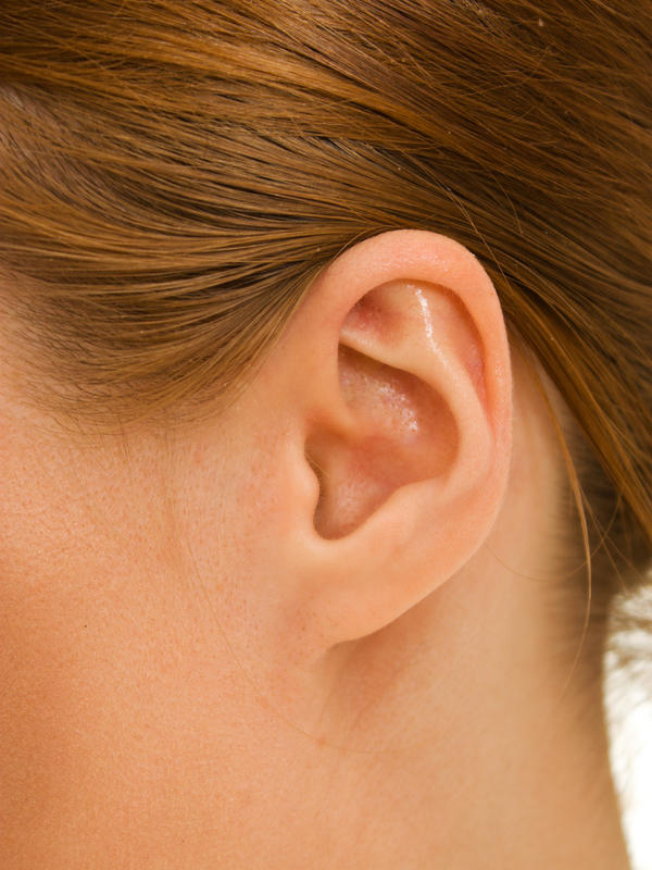 18 yo who had her upper ear lobe pierced 2 wks ago. It is red and slightly painful. She now has a small lymph node on the back of her neck. Related?