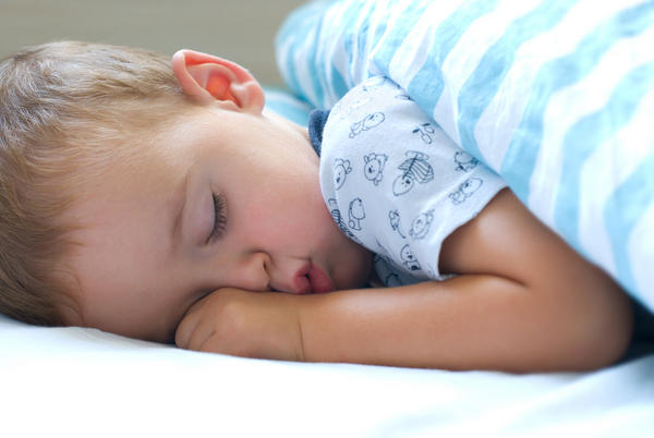 How do I make a stiff neck (from sleeping in a bad position) better for a child?