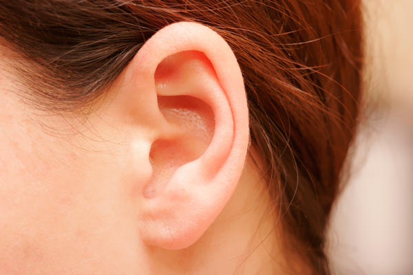 What is the cause of  pressure behind  the ear?