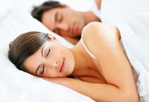 What is the best sleep position with a urinary catheter?