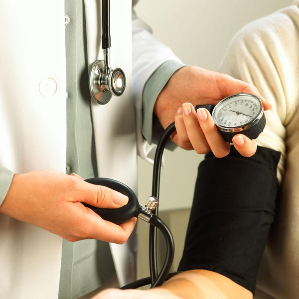 What is the medical term for arthritis that causes pain in the head that is similar to hypertension symptoms?