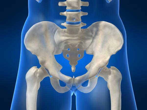 What could cause groin pain and joint pain 8 months after total hip replacement?