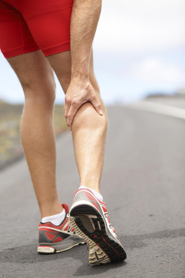 Why do I experience intense abdominal muscle pain and cramping while running?