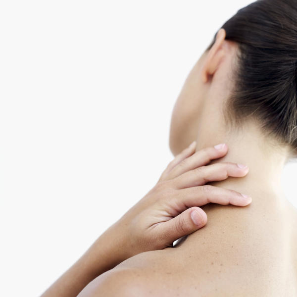What is the cause of neck pain getting decreased on tilting head ?