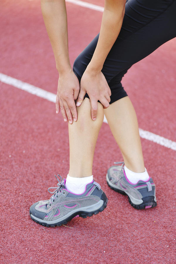 How do a charley horse and calf pain differ?