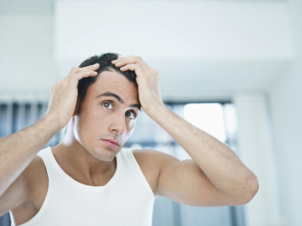 What causes loss of hair of the axilla?