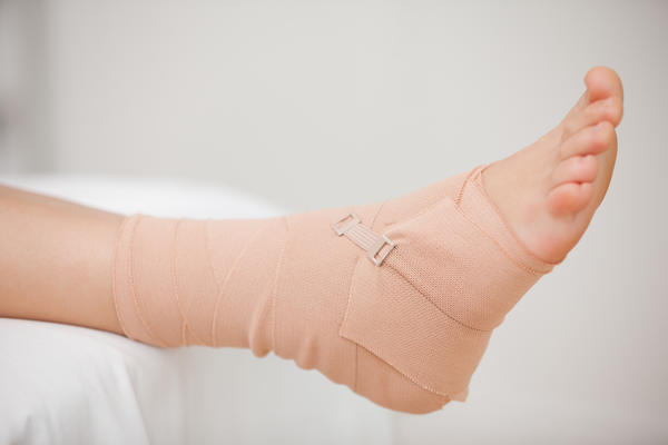 Should I use an ACE wrap or ankle brace for my sprained ankle?