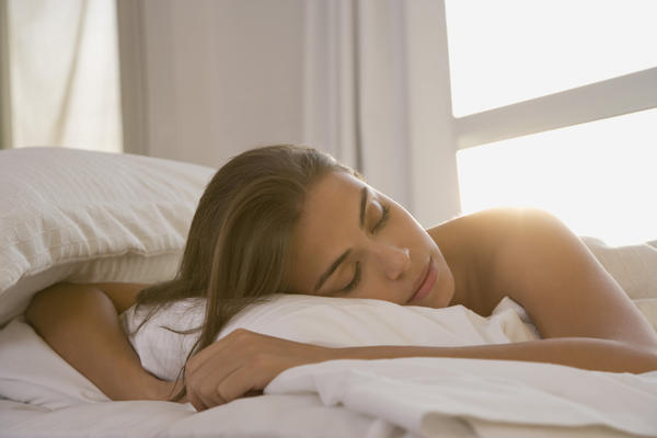 What causes involuntary movement while sleeping?