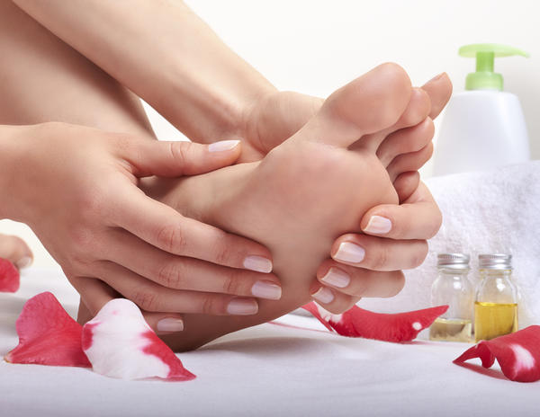 How come tissue fluid accumulates at ankles and feet?