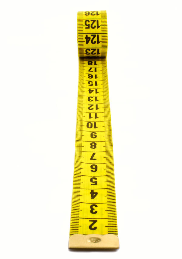 What is the proper weight form a female age 15 height 5`7?