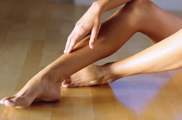 What causes leg pain after prolonged sitting?