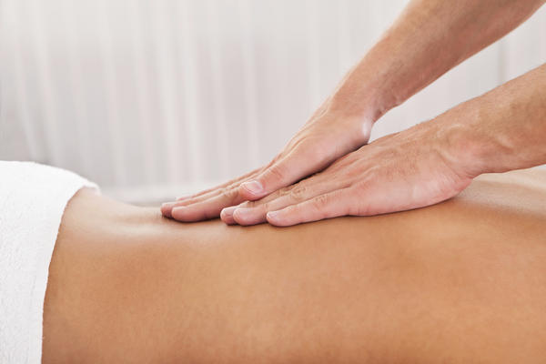 Would a massage help in the intermediate aftermath of an aggravation of a lower-back herniation?